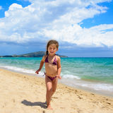 Cute little girl running on the beach Royalty Free Stock Images