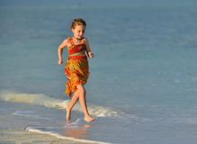 Cute little girl running on beach in sunset. Cute little girl running on the beach in sunset light. Cuba. Caya Coco Royalty Free Stock Photos