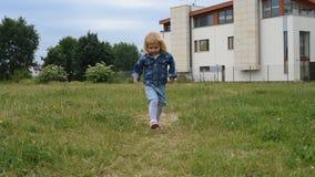 Cute little girl runs stock footage