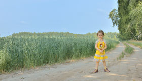 Cute little girl on rural road Royalty Free Stock Images