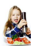 Cute little girl with salad and pepper box Royalty Free Stock Photo