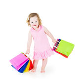 Cute little girl after sale with her colorful bags Stock Images