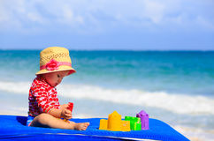 Cute little girl  with sand toys on the beach Stock Photos
