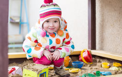 Cute little girl in a sandbox Royalty Free Stock Photos