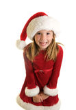 A Cute Little Girl in A Santa Claus Hat and Christmas Dress Stock Photos