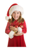 A Cute Little Girl in A Santa Claus Hat and Christmas Dress Royalty Free Stock Images
