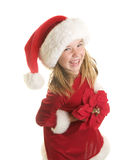 A Cute Little Girl in A Santa Claus Hat and Dress holding a Poinsettia Royalty Free Stock Photo
