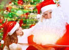 Cute little girl with Santa Claus Stock Image