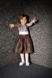 Cute little girl scares Royalty Free Stock Photography