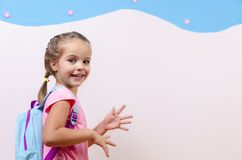 Cute little girl with school bag. / backpack in her room, copy space Royalty Free Stock Photography