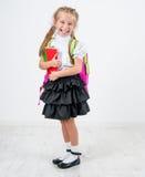 Cute little girl in school uniform Royalty Free Stock Photos