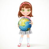 Cute little girl in school uniform holding a globe in hands Royalty Free Stock Image