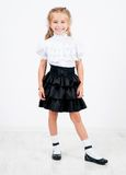 Cute little girl in school uniform Royalty Free Stock Photo