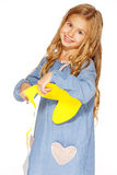 Cute little girl with scissors and yellow paper. Little cute girl making handmade yellow hearts Stock Photography