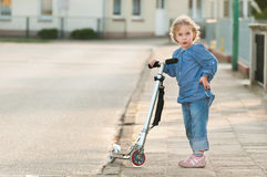 Cute little girl with scooter Stock Photo