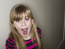 Cute little girl screaming about something. Smiling little girl sees something that makes her very happy she screams with delight Stock Photography