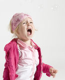 Cute little girl screeming Stock Images