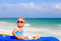 Cute little girl  with seashells on the beach Royalty Free Stock Image