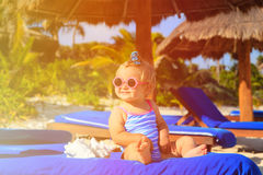 Cute little girl with seashells on summer beach Stock Photography