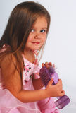 Cute little girl with shoe Stock Images