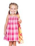 Cute little girl with shopping bag. Beautiful little girl with shopping bag isolated on white background Stock Photo