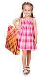 Cute little girl with shopping bag. Isolated on white background Royalty Free Stock Image