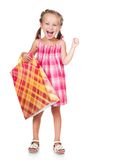 Cute little girl with shopping bag. Smiling little girl with shopping bag isolated on white background Stock Photo