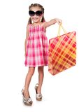 Cute little girl with shopping bag. In sunglasses isolated on white background Stock Images