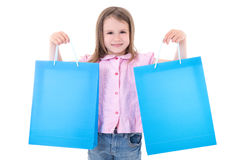Cute little girl with shopping bags isolated on white royalty free stock image