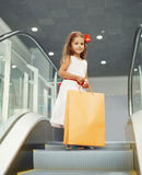 Cute little girl with shopping bags Royalty Free Stock Image