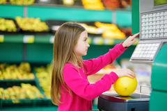 Cute little girl shopping in a food store Royalty Free Stock Photo
