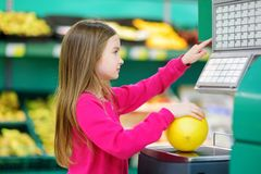 Cute little girl shopping in a food store Stock Image