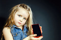 Free Cute Little Girl Showing Blank Screen Of Modern Smartphone Royalty Free Stock Images - 48604519