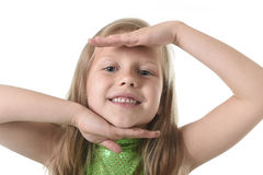 Cute little girl showing face in body parts learning school chart serie Royalty Free Stock Photography