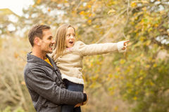 Cute little girl showing her father something Stock Photos