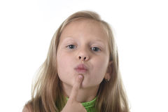 Cute little girl showing her lips in body parts learning school chart serie. 6 or 7 years old little girl with blond hair and blue eyes smiling happy posing stock photo