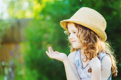 Cute little girl  showing or present empty open hand palm. Advan Royalty Free Stock Photography
