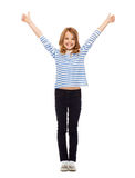 Cute little girl showing thumbs up. Education, school and gesture concept - cute little girl showing thumbs up Royalty Free Stock Photo