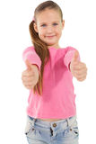 Cute little girl showing thumbs up Stock Photo