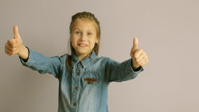 Cute little girl shows thumb up stock video