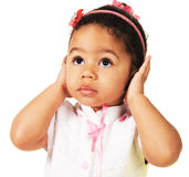 Cute little girl shutting dawn her ears. White background Stock Photography
