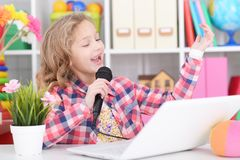 Cute little girl singing karaoke. With microphone Royalty Free Stock Photo