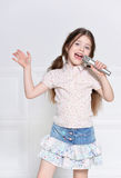 Cute little girl singing Royalty Free Stock Photo