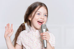 Cute little girl singing Stock Photo