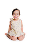 Cute little girl sit on the floor Stock Images