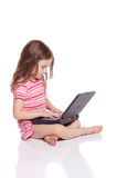 Cute girl with a laptop Stock Photos