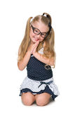 Cute little girl sits Royalty Free Stock Photography