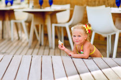 Cute little girl sits have a snack outdoor Stock Photography