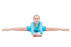 Cute little girl sits on a splits. Isolated on white background Royalty Free Stock Images