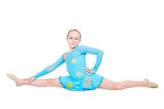 Cute little girl sits on a splits. Isolated on white background Stock Image